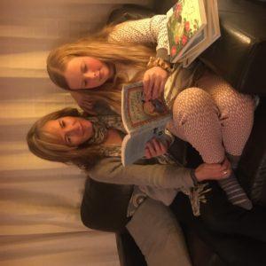 Vida and Elsa reading the series