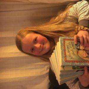 Elsa reading the series
