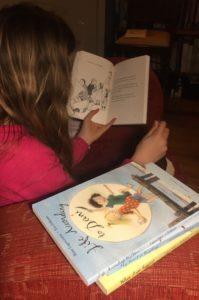 Child reading My Happy Life series